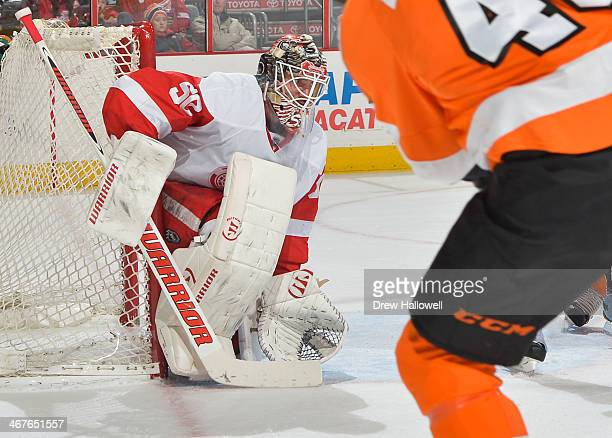 Jonas Gustavsson of the Detroit Red Wings gets set during the game against the Philadelphia Flyers at the Wells Fargo Center on January 28 2014 in...