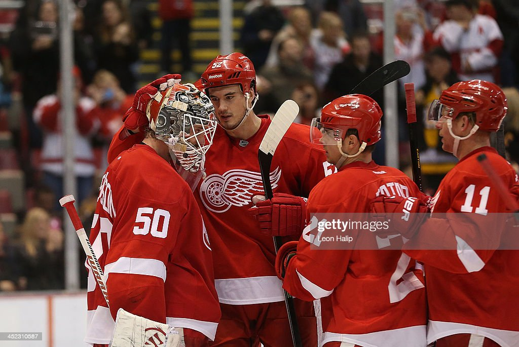 <a gi-track='captionPersonalityLinkClicked' href=/galleries/search?phrase=Jonas+Gustavsson&family=editorial&specificpeople=886789 ng-click='$event.stopPropagation()'>Jonas Gustavsson</a> #50 of the Detroit Red Wings is congratulated by teammates <a gi-track='captionPersonalityLinkClicked' href=/galleries/search?phrase=Jonathan+Ericsson&family=editorial&specificpeople=2538498 ng-click='$event.stopPropagation()'>Jonathan Ericsson</a> #52 <a gi-track='captionPersonalityLinkClicked' href=/galleries/search?phrase=Tomas+Tatar&family=editorial&specificpeople=5652303 ng-click='$event.stopPropagation()'>Tomas Tatar</a> #21 and Daniel Alfredson #11 after the Red Wings defeated the Bruins at Joe Louis Arena on November 27, 2013 in Detroit, Michigan. The Red Wings Defeated the Bruins 6-1.