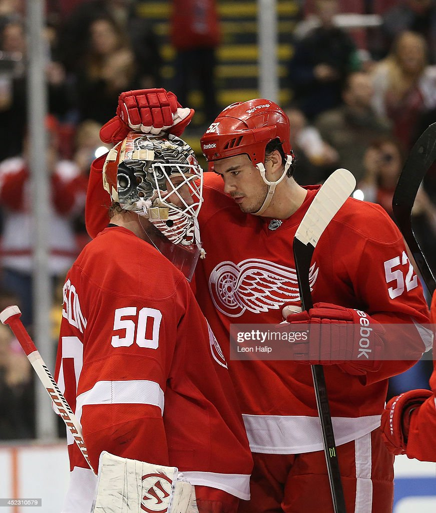 <a gi-track='captionPersonalityLinkClicked' href=/galleries/search?phrase=Jonas+Gustavsson&family=editorial&specificpeople=886789 ng-click='$event.stopPropagation()'>Jonas Gustavsson</a> #50 of the Detroit Red Wings is congratulated by teammate <a gi-track='captionPersonalityLinkClicked' href=/galleries/search?phrase=Jonathan+Ericsson&family=editorial&specificpeople=2538498 ng-click='$event.stopPropagation()'>Jonathan Ericsson</a> #52 after the Red Wings defeated the Bruins at Joe Louis Arena on November 27, 2013 in Detroit, Michigan. The Red Wings Defeated the Bruins 6-1.