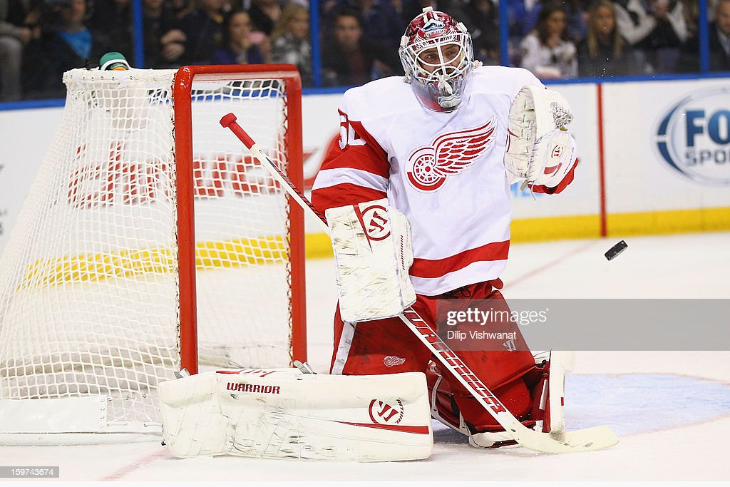 <a gi-track='captionPersonalityLinkClicked' href=/galleries/search?phrase=Jonas+Gustavsson&family=editorial&specificpeople=886789 ng-click='$event.stopPropagation()'>Jonas Gustavsson</a> #50 of the Detroit Red wings makes a save against the St. Louis Blues at the Scottrade Center on January 19, 2013 in St. Louis, Missouri.