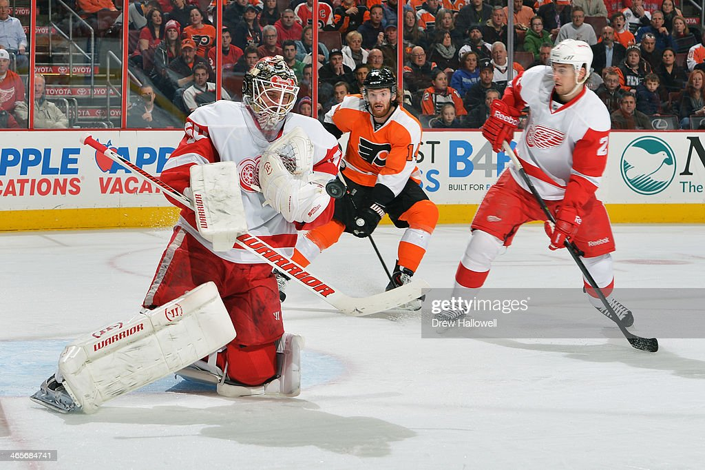 <a gi-track='captionPersonalityLinkClicked' href=/galleries/search?phrase=Jonas+Gustavsson&family=editorial&specificpeople=886789 ng-click='$event.stopPropagation()'>Jonas Gustavsson</a> #50 of the Detroit Red Wings makes a save as Sean Couturier #14 of the Philadelphia Flyers and Brendan Smith #2 of the Red Wings watch at the Wells Fargo Center on January 28, 2014 in Philadelphia, Pennsylvania.