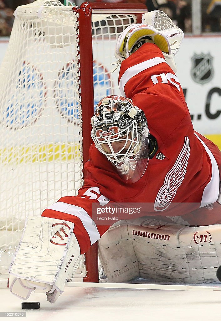 <a gi-track='captionPersonalityLinkClicked' href=/galleries/search?phrase=Jonas+Gustavsson&family=editorial&specificpeople=886789 ng-click='$event.stopPropagation()'>Jonas Gustavsson</a> #50 of the Detroit Red Wings makes the save late during the third period of the game against the Boston Bruins at Joe Louis Arena on November 27, 2013 in Detroit, Michigan. The Red Wings Defeated the Bruins 6-1.