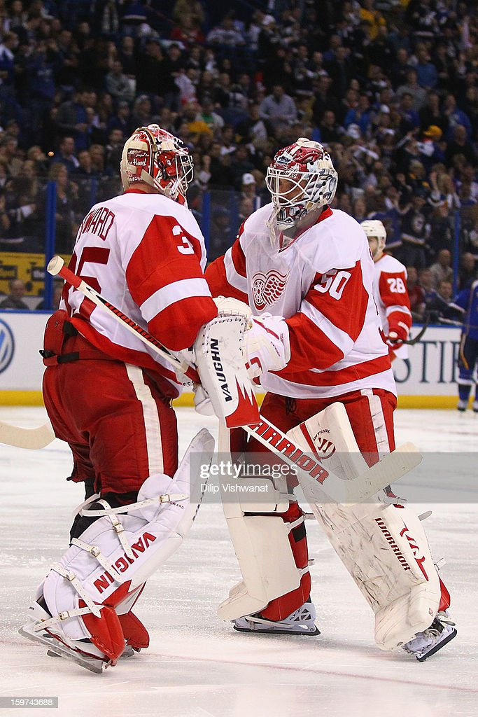 <a gi-track='captionPersonalityLinkClicked' href=/galleries/search?phrase=Jonas+Gustavsson&family=editorial&specificpeople=886789 ng-click='$event.stopPropagation()'>Jonas Gustavsson</a> #50 of the Detroit Red wings replaces <a gi-track='captionPersonalityLinkClicked' href=/galleries/search?phrase=Jimmy+Howard&family=editorial&specificpeople=2118637 ng-click='$event.stopPropagation()'>Jimmy Howard</a> #35 \also of the Detroit Red wings at the Scottrade Center on January 19, 2013 in St. Louis, Missouri.