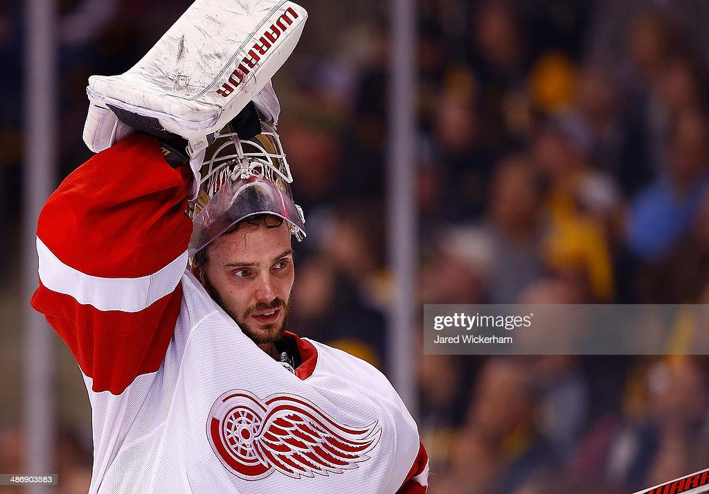 <a gi-track='captionPersonalityLinkClicked' href=/galleries/search?phrase=Jonas+Gustavsson&family=editorial&specificpeople=886789 ng-click='$event.stopPropagation()'>Jonas Gustavsson</a> #50 of the Detroit Red Wings takes his mask off while in goal in the third period against the Boston Bruins in Game Five of the First Round of the 2014 NHL Stanley Cup Playoffs at TD Garden on April 26, 2014 in Boston, Massachusetts.