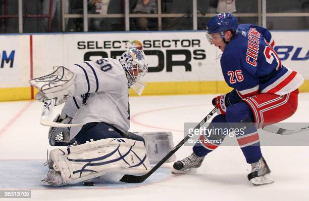 Jonas Gustavsson of the Toronto Maple Leafs makes a secondperiod save on Erik Christensen of the New York Rangers at Madison Square Garden on April 7...