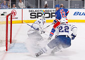 Jonas Gustavsson of the Toronto Maple Leafs protects the net against Olli Jokinen of the New York Rangers in the first period on April 7 2010 at...