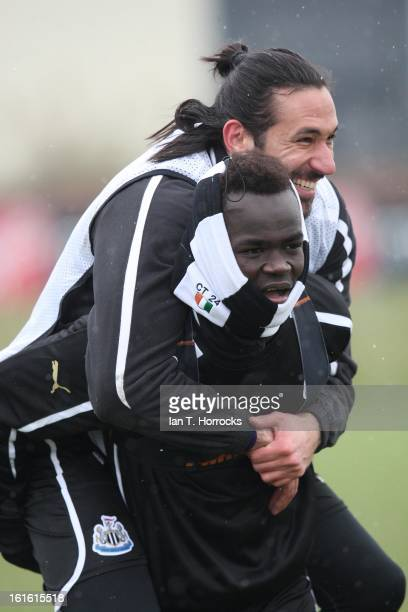 Jonas Gutierrez gets a piggy back from Cheik Tiote during a Newcastle United Training Session at the Little Benton training ground on February 13...