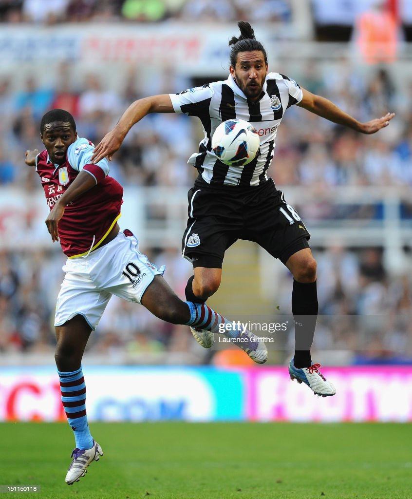 <a gi-track='captionPersonalityLinkClicked' href=/galleries/search?phrase=Jonas+Gutierrez&family=editorial&specificpeople=771739 ng-click='$event.stopPropagation()'>Jonas Gutierrez</a> of Newcastle battles with <a gi-track='captionPersonalityLinkClicked' href=/galleries/search?phrase=Charles+N%27Zogbia&family=editorial&specificpeople=639159 ng-click='$event.stopPropagation()'>Charles N'Zogbia</a> of Aston Villa during the Barclays Premier League match between Newcastle United and Aston Villa at Sports Direct Arena on September 2, 2012 in Newcastle upon Tyne, England.