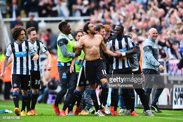 Jonas Gutierrez of Newcastle United celebrates scoring his team's second goal with his team mates during the Barclays Premier League match between...