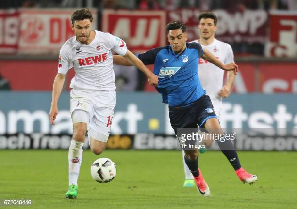 Jonas Hector and Nadiem Amiri battle for the ball during the Bundesliga match between 1 FC Koeln and TSG 1899 Hoffenheim at RheinEnergieStadion on...