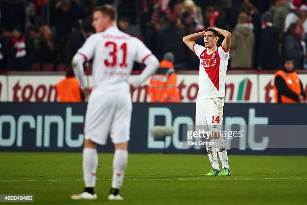 Jonas Hector and Yannick Gerhardt of Koeln react after the Bundesliga match between 1 FC Koeln and FC Augsburg at RheinEnergieStadion on December 6...