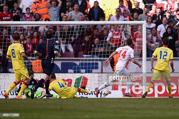Jonas Hector of 1 FC Koeln scores the third goal during the Bundesliga match between 1 FC Koeln and 1899 Hoffenheim at RheinEnergieStadion on April...
