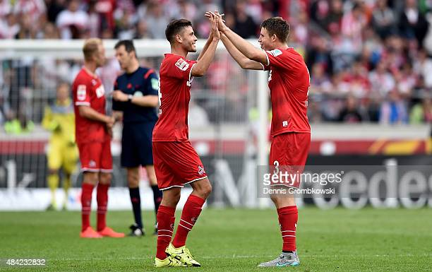 Jonas Hector of 1FC Koeln celebrates with Dominique Heintz of 1FC Koeln after winning the Bundesliga match between VfB Stuttgart and 1 FC Koeln at...