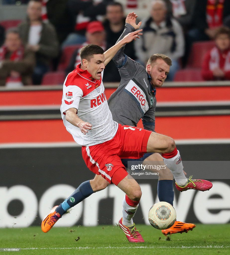 Jonas Hector of Cologne (L) tackles Daniel Brosinski of Fuerth during the 2nd Bundesliga match between 1. FC Koeln and Greuther Fuerth at RheinEnergieStadion on February 24, 2014 in Cologne, Germany.