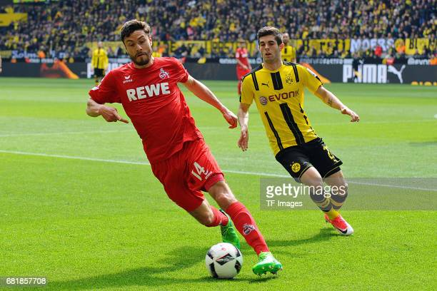 Jonas Hector of Colonge and Christian Pulisic of Dortmund battle for the ball during the Bundesliga match between Borussia Dortmund and FC Koeln at...