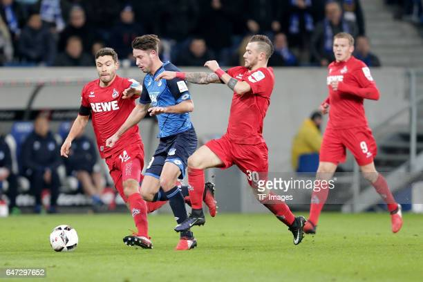 Jonas Hector of FC Koeln and Mark Uth of Hoffenheim and Marcel Hartel of FC Koeln battle for the ball during the Bundesliga match between TSG 1899...