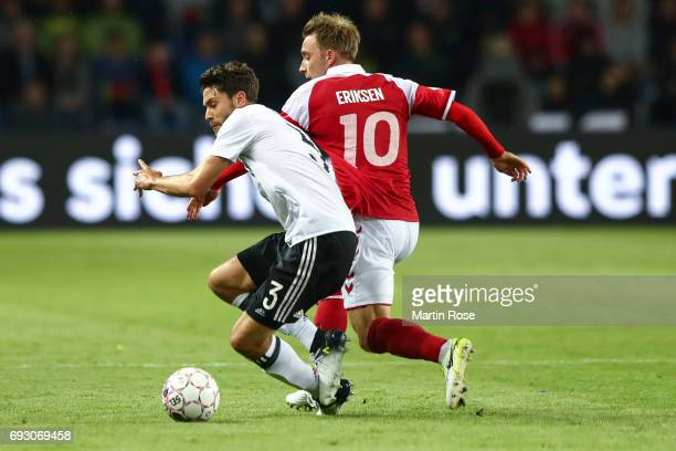 Jonas Hector of Germany and Christian Eriksen of Denmark battle for the ball during the international friendly match between Denmark v Germany on...