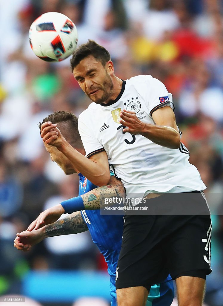 <a gi-track='captionPersonalityLinkClicked' href=/galleries/search?phrase=Jonas+Hector&family=editorial&specificpeople=8121522 ng-click='$event.stopPropagation()'>Jonas Hector</a> of Germany and <a gi-track='captionPersonalityLinkClicked' href=/galleries/search?phrase=Juraj+Kucka&family=editorial&specificpeople=6388600 ng-click='$event.stopPropagation()'>Juraj Kucka</a> of Slovakia compete for the ball during the UEFA EURO 2016 round of 16 match between Germany and Slovakia at Stade Pierre-Mauroy on June 26, 2016 in Lille, France.