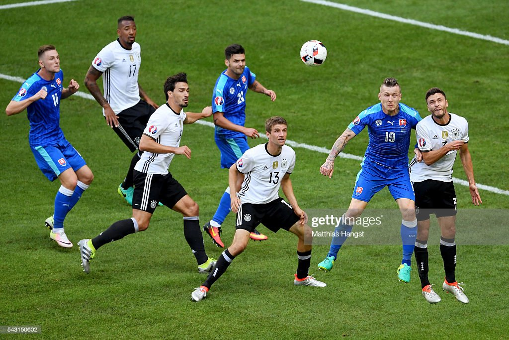 <a gi-track='captionPersonalityLinkClicked' href=/galleries/search?phrase=Jonas+Hector&family=editorial&specificpeople=8121522 ng-click='$event.stopPropagation()'>Jonas Hector</a> (1st R) of Germany and <a gi-track='captionPersonalityLinkClicked' href=/galleries/search?phrase=Juraj+Kucka&family=editorial&specificpeople=6388600 ng-click='$event.stopPropagation()'>Juraj Kucka</a> (2nd R) of Slovakia compete for the ball during the UEFA EURO 2016 round of 16 match between Germany and Slovakia at Stade Pierre-Mauroy on June 26, 2016 in Lille, France.
