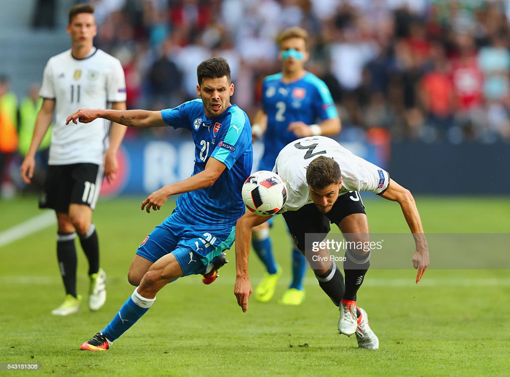 <a gi-track='captionPersonalityLinkClicked' href=/galleries/search?phrase=Jonas+Hector&family=editorial&specificpeople=8121522 ng-click='$event.stopPropagation()'>Jonas Hector</a> of Germany and Michal Duris of Slovakia compete for the ball during the UEFA EURO 2016 round of 16 match between Germany and Slovakia at Stade Pierre-Mauroy on June 26, 2016 in Lille, France.