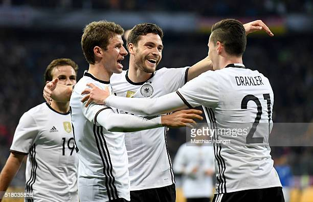 Jonas Hector of Germany celebrates with team mates after scoring his teams third goal during the International Friendly match between Germany and...