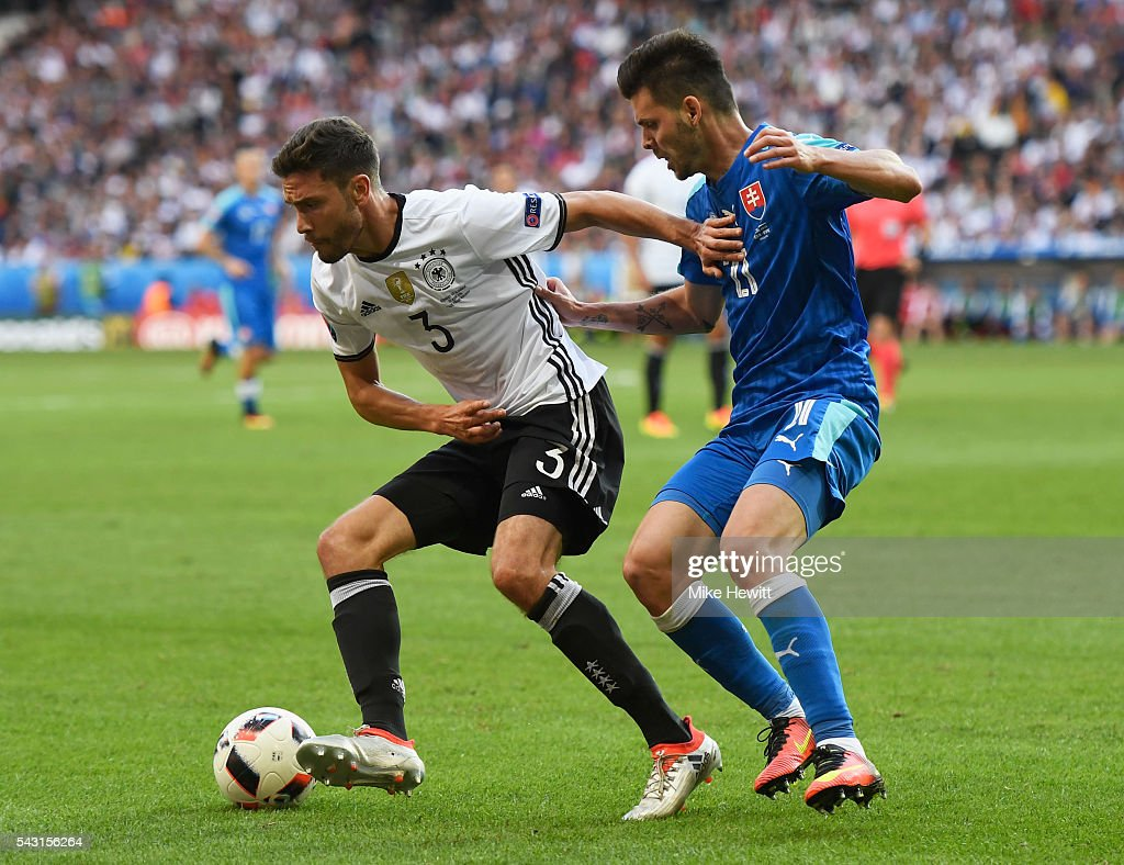<a gi-track='captionPersonalityLinkClicked' href=/galleries/search?phrase=Jonas+Hector&family=editorial&specificpeople=8121522 ng-click='$event.stopPropagation()'>Jonas Hector</a> of Germany controls the ball under pressure of Michal Duris of Slovakia during the UEFA EURO 2016 round of 16 match between Germany and Slovakia at Stade Pierre-Mauroy on June 26, 2016 in Lille, France.