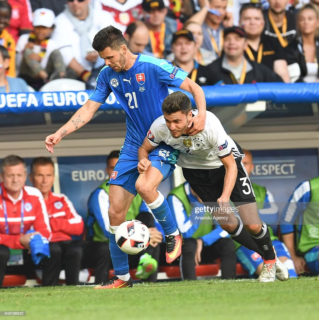 Jonas Hector (R) of Germany in action against Michal Duris (L) of Slovakia during the UEFA Euro 2016 round of 16 football match between Germany and Slovakia at Stade Pierre Mauroy in Lille, France on June 26, 2016.