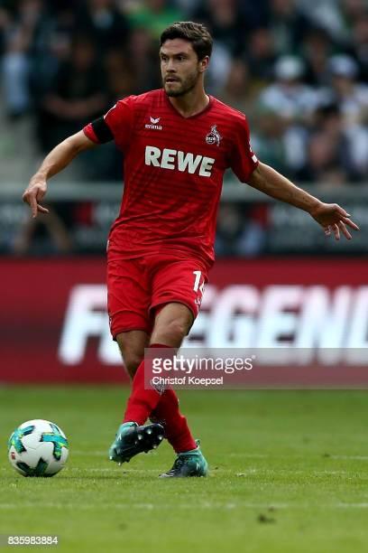 Jonas Hector of Kln runs with the ball during the Bundesliga match between Borussia Moenchengladbach and 1 FC Koeln at BorussiaPark on August 20 2017...