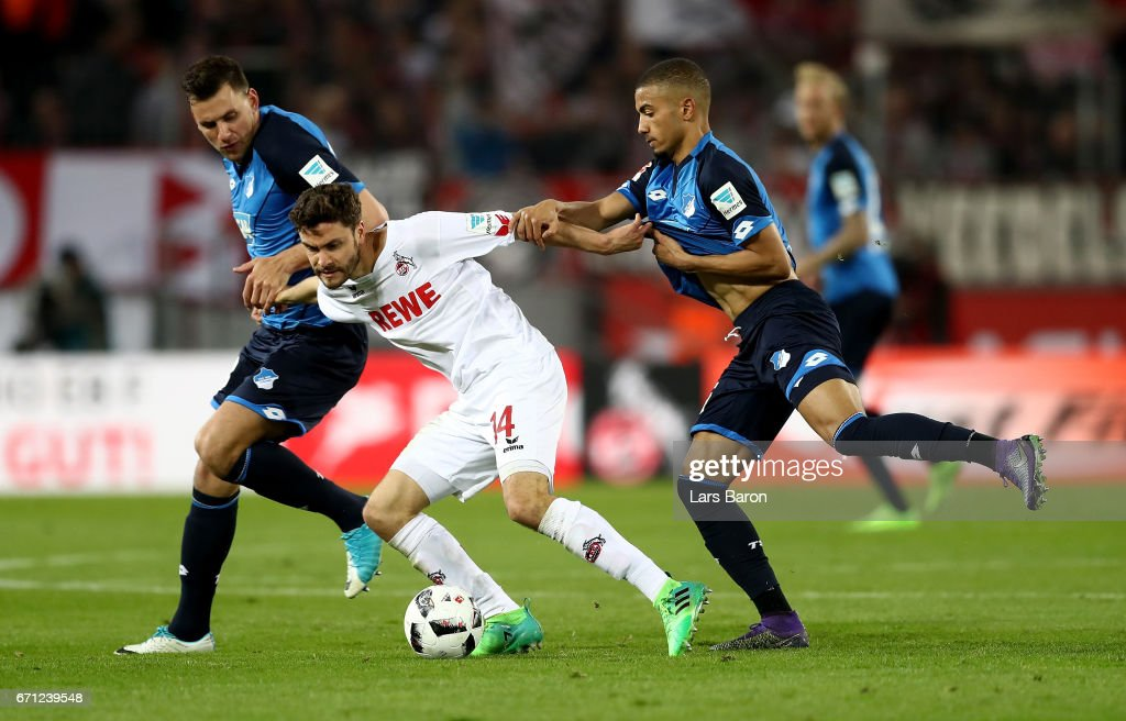 Jonas Hector (C) of Koeln and Adam Szalai (L) and Jeremy Toljan of Hoffenheim battle for the ball during the Bundesliga match between 1. FC Koeln and TSG 1899 Hoffenheim at RheinEnergieStadion on April 21, 2017 in Cologne, Germany.