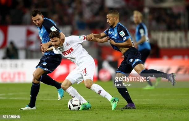 Jonas Hector of Koeln and Adam Szalai and Jeremy Toljan of Hoffenheim battle for the ball during the Bundesliga match between 1 FC Koeln and TSG 1899...