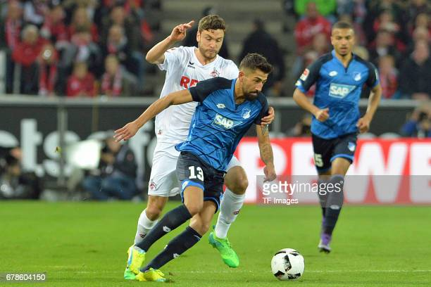 Jonas Hector of Koeln and Kerem Demirbay of Hoffenheim battle for the ball during the Bundesliga match between 1 FC Koeln and TSG 1899 Hoffenheim at...