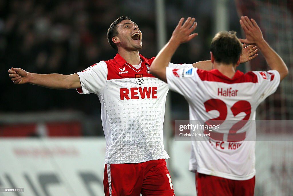 Jonas Hector of Koeln celebrates the forth goal with Daniel Halfar of Koeln during the Second Bundesliga match between 1. FC Koeln and 1. FC Union Berlin at RheinEnergieStadion on November 4, 2013 in Cologne, Germany.