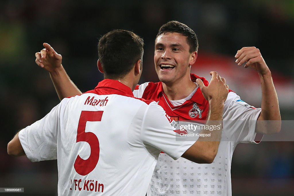 Jonas Hector of Koeln (R) celebrates the forth goal with <a gi-track='captionPersonalityLinkClicked' href=/galleries/search?phrase=Dominic+Maroh&family=editorial&specificpeople=5633010 ng-click='$event.stopPropagation()'>Dominic Maroh</a> of Koeln (L) during the Second Bundesliga match between 1. FC Koeln and 1. FC Union Berlin at RheinEnergieStadion on November 4, 2013 in Cologne, Germany.