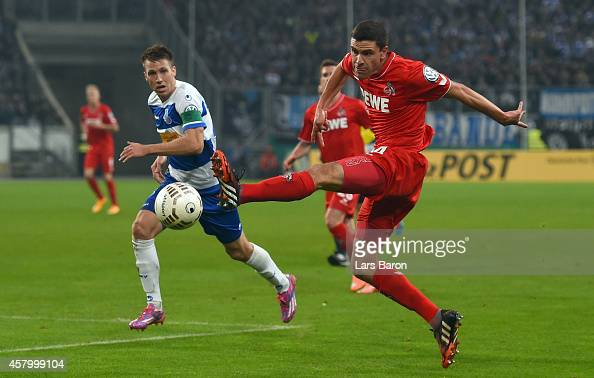 Jonas Hector of Koeln jumps for the ball next to Steffen Bohl of Duisburg during the DFB Cup second round match between MSV Duisburg and 1 FC Koeln...