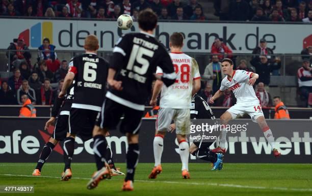 Jonas Hector of Koeln scores his teams first goal during the Second Bundesliga match between 1 FC Koeln and Energie Cottbus at RheinEnergieStadion on...