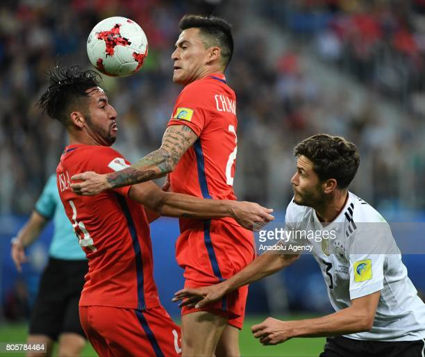 Jonas Hektor of Germany in action against Mauricio Isla and Charles Aranguiz of Chile during the Confederations Cup 2017 Final match Chile Germany at...