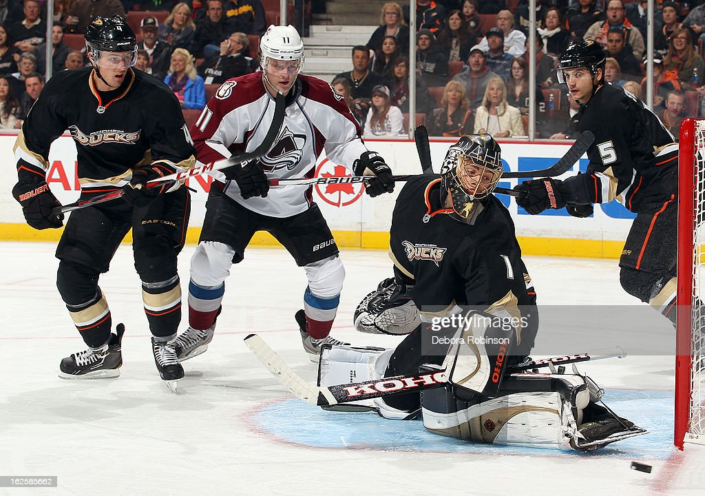 Jonas Hiller #1, Cam Fowler #4 and Luca Sbisa #5 of the Anaheim Ducks and Jamie McGinn #11 of the Colorado Avalanche watch the puck go by during the game on February 24, 2013 at Honda Center in Anaheim, California.