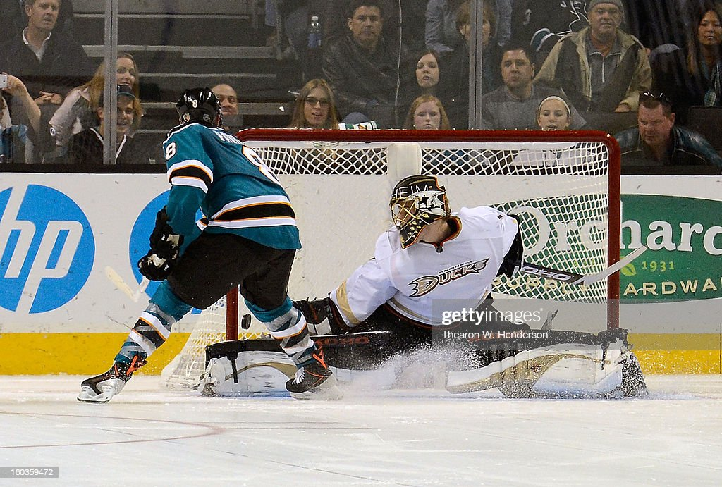 Jonas Hiller #1 of the Anaheim Ducks blocks the shot of Joe Pavelski #8 of the San Jose Sharks during an overtime shoot-out at HP Pavilion on January 29, 2013 in San Jose, California. The Sharks won the game 3-2 in the overtime shoot-out.