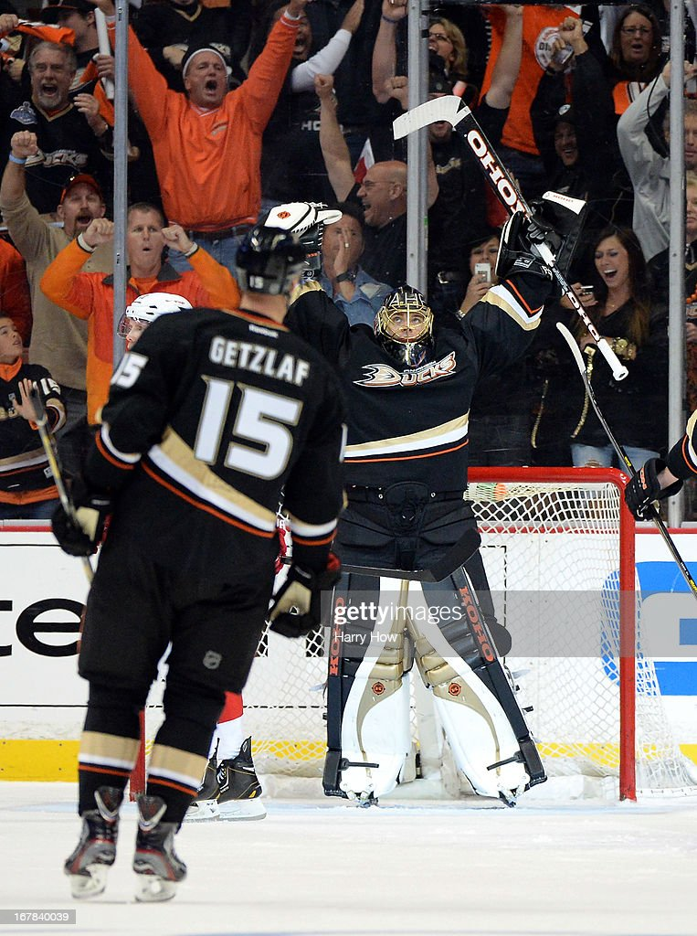Jonas Hiller #1 of the Anaheim Ducks celebrates the empty net goal of Francois Beauchemin #23 for a 3-1 lead in front of Ryan Getzlaf #15 in Game One of the Western Conference Quarterfinals during the 2013 Stanley Cup Playoffs at Honda Center on April 30, 2013 in Anaheim, California. The Ducks won 3-1.
