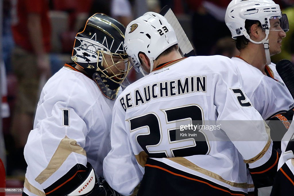 <a gi-track='captionPersonalityLinkClicked' href=/galleries/search?phrase=Jonas+Hiller&family=editorial&specificpeople=743364 ng-click='$event.stopPropagation()'>Jonas Hiller</a> #1 of the Anaheim Ducks is congratulated by Francois Beauchemin #23 of the Anaheim Ducks after defeating the Detroit Red Wings 4-0 in Game Three of the Western Conference Quarterfinals during the 2013 NHL Stanley Cup Playoffs on May 4, 2013 at Joe Lewis Arena in Detroit, Michigan.