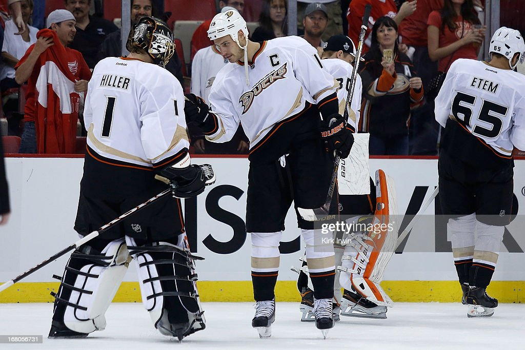 <a gi-track='captionPersonalityLinkClicked' href=/galleries/search?phrase=Jonas+Hiller&family=editorial&specificpeople=743364 ng-click='$event.stopPropagation()'>Jonas Hiller</a> #1 of the Anaheim Ducks is congratulated by <a gi-track='captionPersonalityLinkClicked' href=/galleries/search?phrase=Ryan+Getzlaf&family=editorial&specificpeople=602655 ng-click='$event.stopPropagation()'>Ryan Getzlaf</a> #15 of the Anaheim Ducks after defeating the Detroit Red Wings 4-0 in Game Three of the Western Conference Quarterfinals during the 2013 NHL Stanley Cup Playoffs on May 4, 2013 at Joe Lewis Arena in Detroit, Michigan.