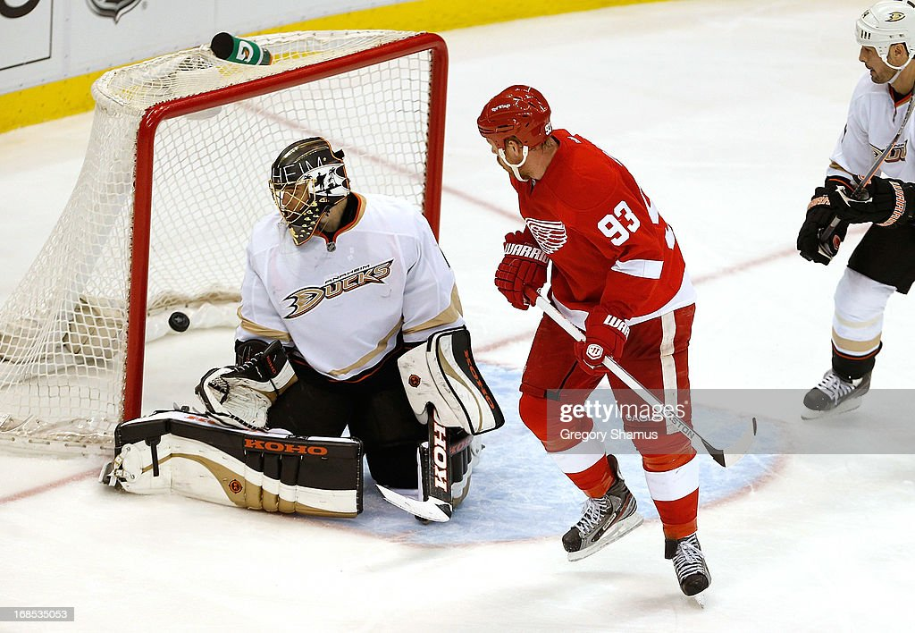 <a gi-track='captionPersonalityLinkClicked' href=/galleries/search?phrase=Jonas+Hiller&family=editorial&specificpeople=743364 ng-click='$event.stopPropagation()'>Jonas Hiller</a> #1 of the Anaheim Ducks looks to see a third-period goal by Henrik Zetterberg #40 of the Detroit Red Wings (not pictured) next to <a gi-track='captionPersonalityLinkClicked' href=/galleries/search?phrase=Johan+Franzen&family=editorial&specificpeople=624356 ng-click='$event.stopPropagation()'>Johan Franzen</a> #93 in Game Six of the Western Conference Quarterfinals during the 2013 NHL Stanley Cup Playoffs at Joe Louis Arena on May 10, 2013 in Detroit, Michigan. Detroit won the game in overtime 4-3 to tie the series 3-3.