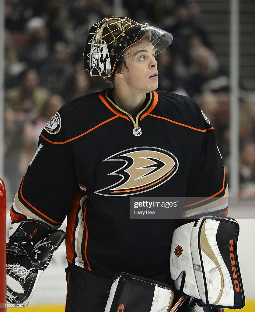 Jonas Hiller #1 of the Anaheim Ducks looks up at the clock during a break trailing 3-0 to the Vancouver Canucks at Honda Center on January 25, 2013 in Anaheim, California.