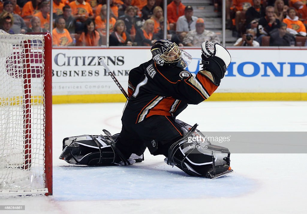 Jonas Hiller #1 of the Anaheim Ducks lunges against the Los Angeles Kings in Game One of the Second Round of the 2014 NHL Stanley Cup Playoffs at Honda Center on May 3, 2014 in Anaheim, California.
