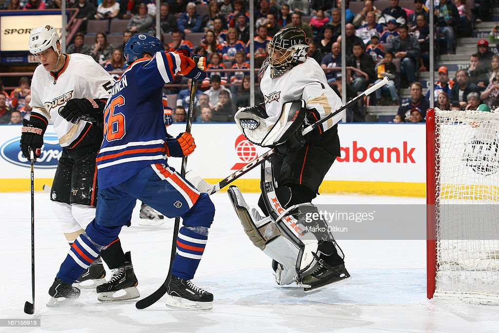 <a gi-track='captionPersonalityLinkClicked' href=/galleries/search?phrase=Jonas+Hiller&family=editorial&specificpeople=743364 ng-click='$event.stopPropagation()'>Jonas Hiller</a> #1 of the Anaheim Ducks makes a save on a shot from <a gi-track='captionPersonalityLinkClicked' href=/galleries/search?phrase=Teemu+Hartikainen&family=editorial&specificpeople=5485386 ng-click='$event.stopPropagation()'>Teemu Hartikainen</a> #56 of the Edmonton Oilers on April 21, 2013 at Rexall Place in Edmonton, Alberta, Canada.