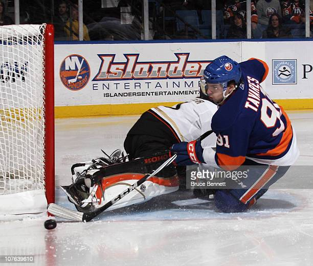 Jonas Hiller of the Anaheim Ducks makes the stop on John Tavares of the New York Islanders at the Nassau Coliseum on December 16 2010 in Uniondale...