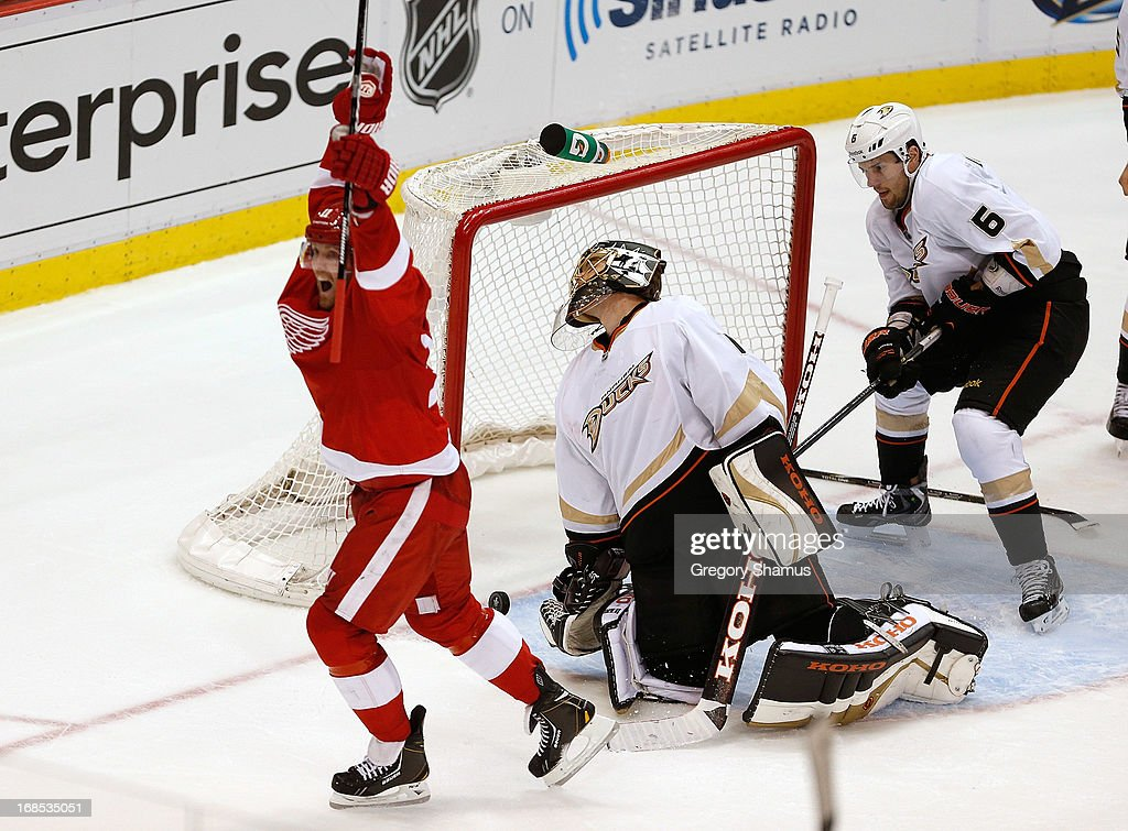 <a gi-track='captionPersonalityLinkClicked' href=/galleries/search?phrase=Jonas+Hiller&family=editorial&specificpeople=743364 ng-click='$event.stopPropagation()'>Jonas Hiller</a> #1 of the Anaheim Ducks reacts next to teammate <a gi-track='captionPersonalityLinkClicked' href=/galleries/search?phrase=Ben+Lovejoy&family=editorial&specificpeople=4509565 ng-click='$event.stopPropagation()'>Ben Lovejoy</a> #6 and <a gi-track='captionPersonalityLinkClicked' href=/galleries/search?phrase=Daniel+Cleary&family=editorial&specificpeople=220490 ng-click='$event.stopPropagation()'>Daniel Cleary</a> #11 of the Detroit Red Wings after a third-period shot by Justin Abdelkader #8 got past him into the net in Game Six of the Western Conference Quarterfinals during the 2013 NHL Stanley Cup Playoffs at Joe Louis Arena on May 10, 2013 in Detroit, Michigan. Detroit won the game in overtime 4-3 to tie the series 3-3.