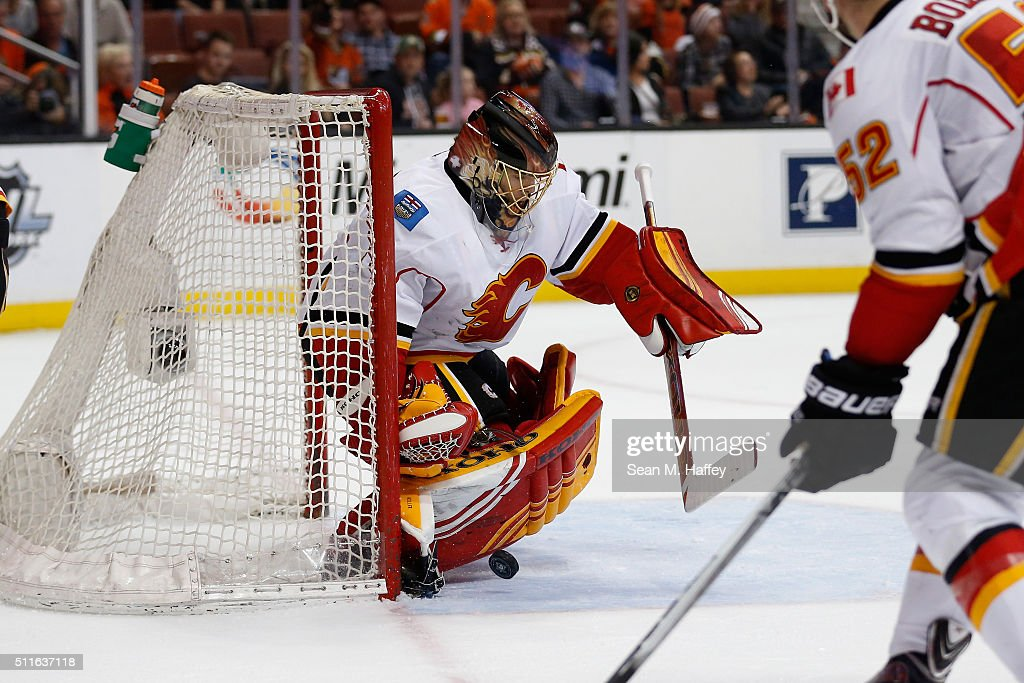 Jonas Hiller #1 of the Calgary Flames blocks a shot on goal during the first period of a game against the Anaheim Ducks at Honda Center on February 21, 2016 in Anaheim, California.