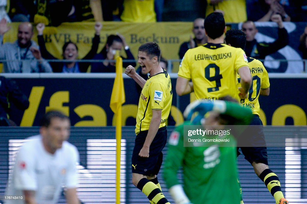 Jonas Hoffmann of Borussia Dortmund celebrates with teammate after scoring his team's first goal during the Bundesliga match between Borussia...