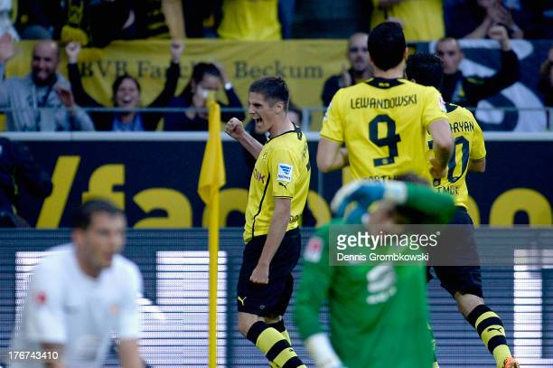 Jonas Hoffmann of Borussia Dortmund celebrates with teammate after scoring his team's first goal during the Bundesliga match between Borussia...